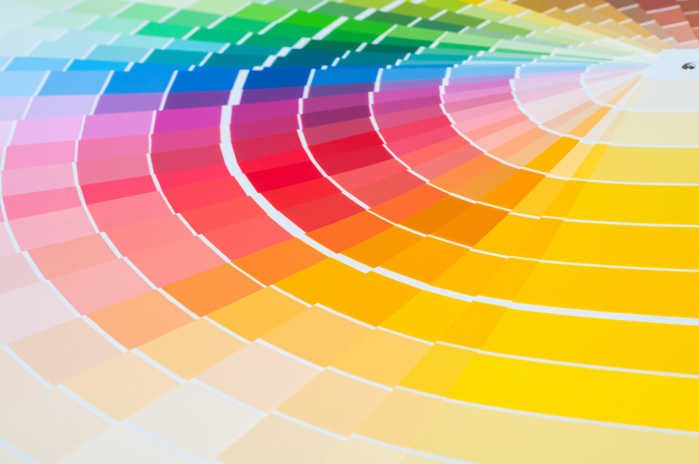 Full spectrum of colors painted on various neatly aligned pieces of paper.