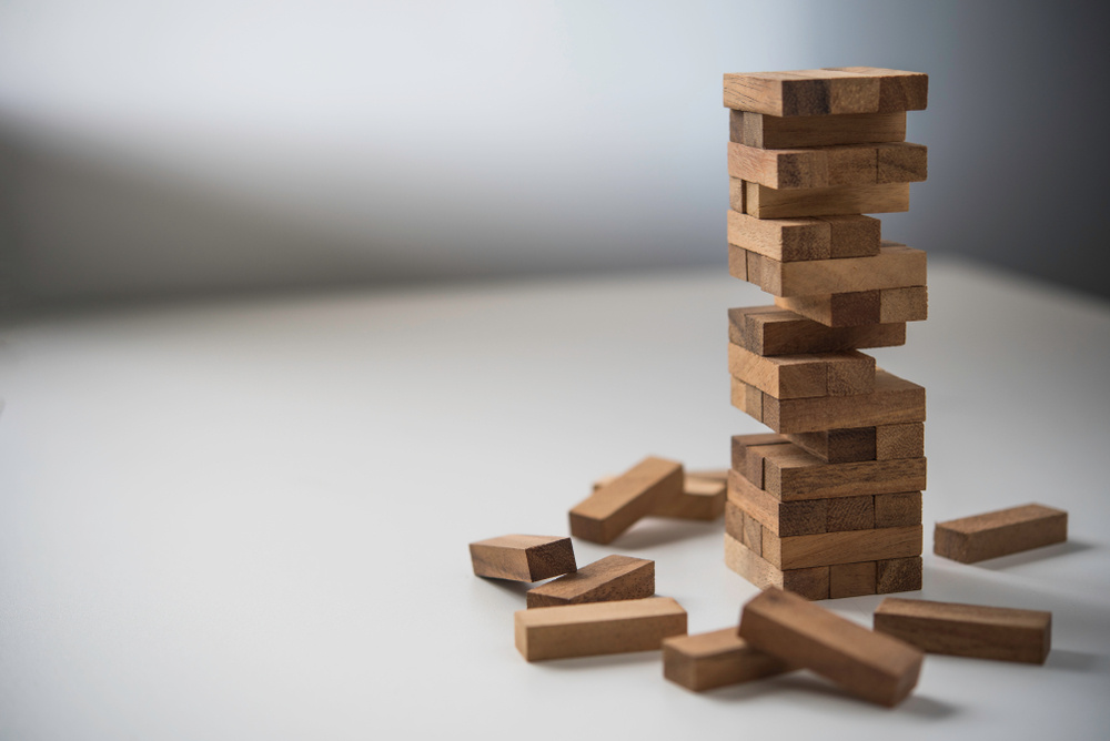 Stack of small playing blocks creating a tower.